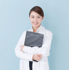 young asian doctor on blue background